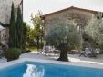 Breakfast in courtyard between pool, poolhouse and olive trees