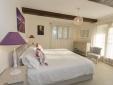 Lavender bedroom - doors open onto the gravel garden