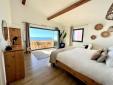 villa's location, sea front, cliffside villa, balconies over the sea