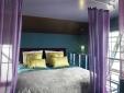Escapada hotel grúa Faralda Amsterdam Holanda confortable cama descansar