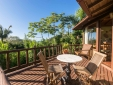 Balcony of the Deluxe Chalet 9 in the middle of nature and a view of Praia do Rosa